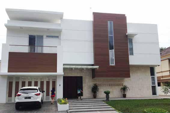 Ejemplo de una fachada ventilada color Ipe